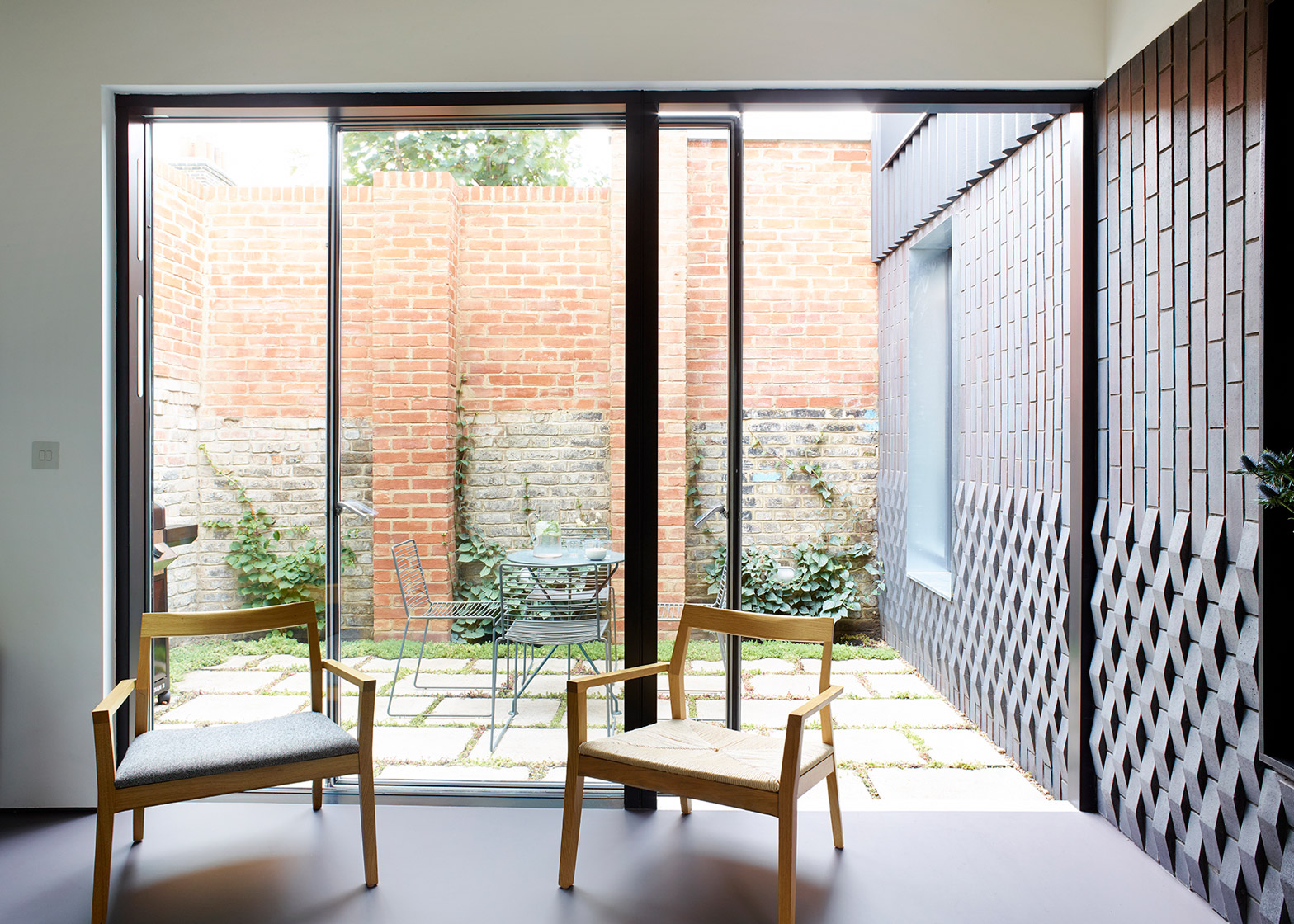 dallas pierce quintero's small london home arranged around courtyards
