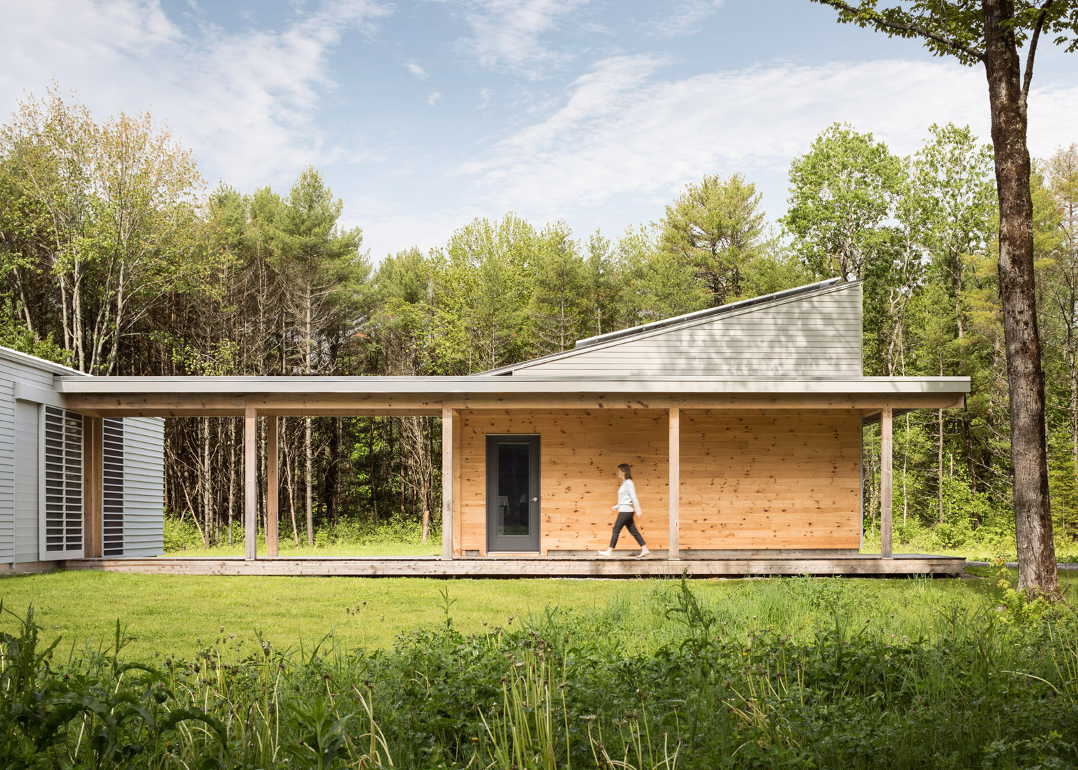 Go logic builds a wooden house in a forest clearing in maine for House plans maine