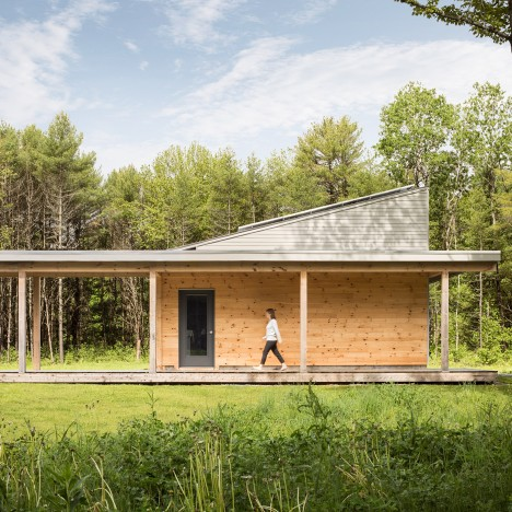 Go Logic builds a wooden house in a forest clearing in Maine