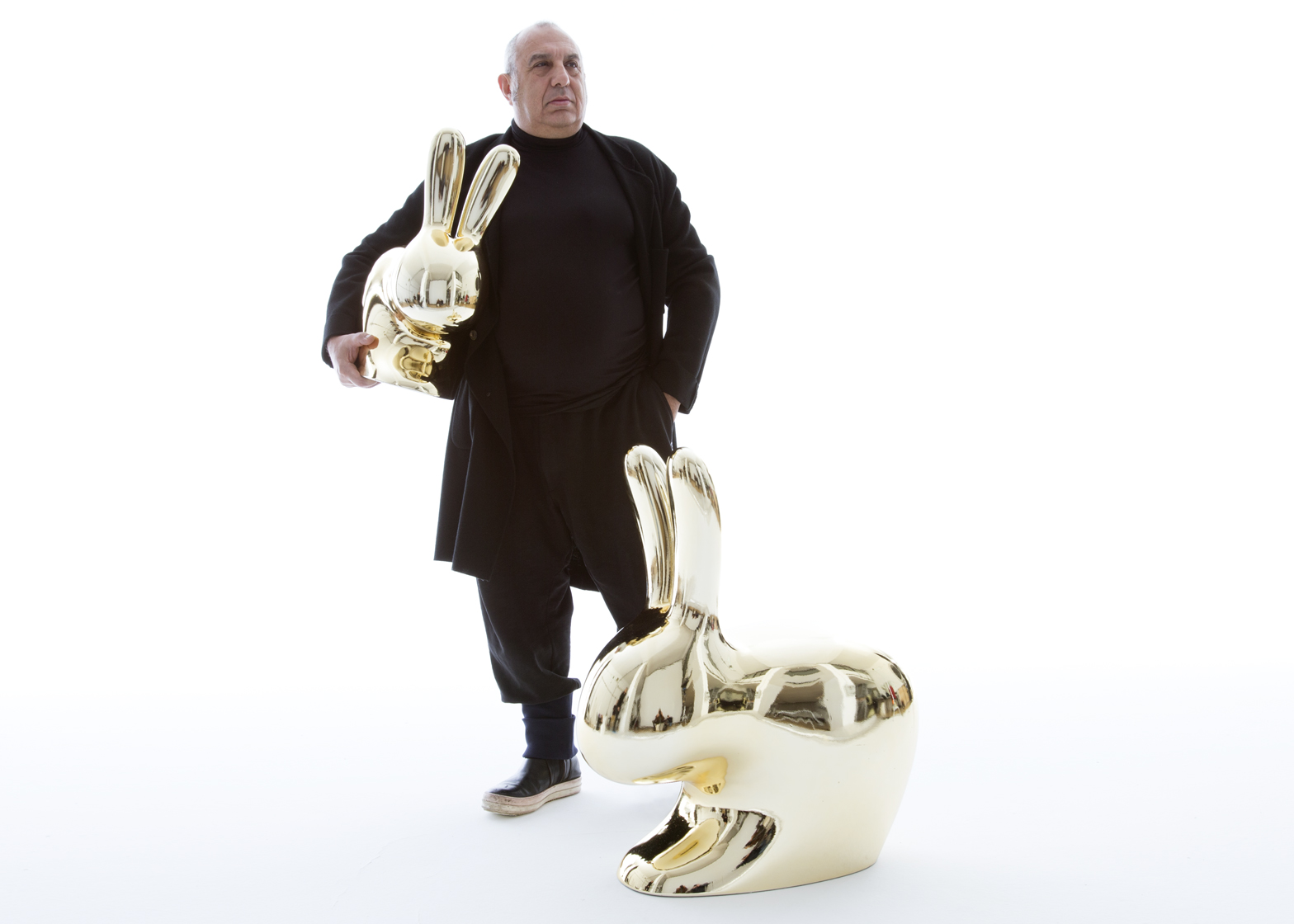 Stefano Giovannoni with his Rabbit chair from the new Qeeboo collection