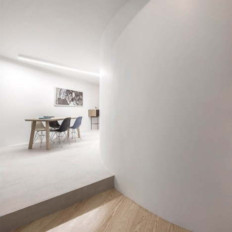 Fala Atelier uses curving wall to shape open-plan interior for historic Lisbon flat