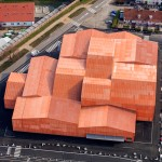 Manuelle Gautrand divides exhibition centre into 13 orange-hued blocks