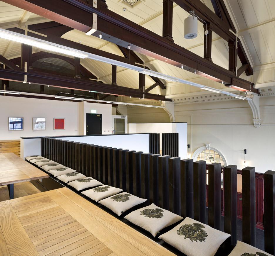 3novices collective architecture extends sandstone building to create glasgow women s library - Open mezzanine ...