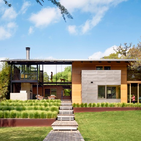 Lake Flato completes spacious Austin home featuring a boardwalk leading to a lake