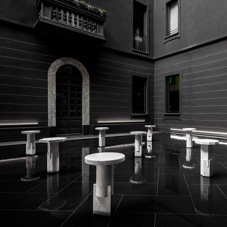 Oeuffice presents collection of solid marble stools at Neoclassical Milanese hotel