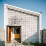 Triangular openings pattern handmade concrete facade of Khuôn Studio's Kontum House