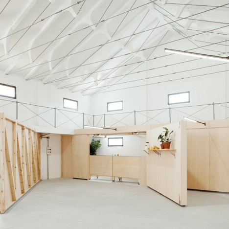 Valentín Sanz converts former warehouse into community centre with a foldaway kitchen