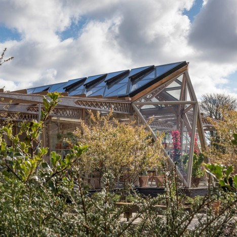 Norman Foster's timber-framed Maggie's Centre opens in his home town of Manchester