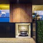 I/O Architects makes classic car focal point of timber-clad house in Sofia