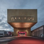 MVRDV and COBE complete Roskilde rock museum dressed with golden studs