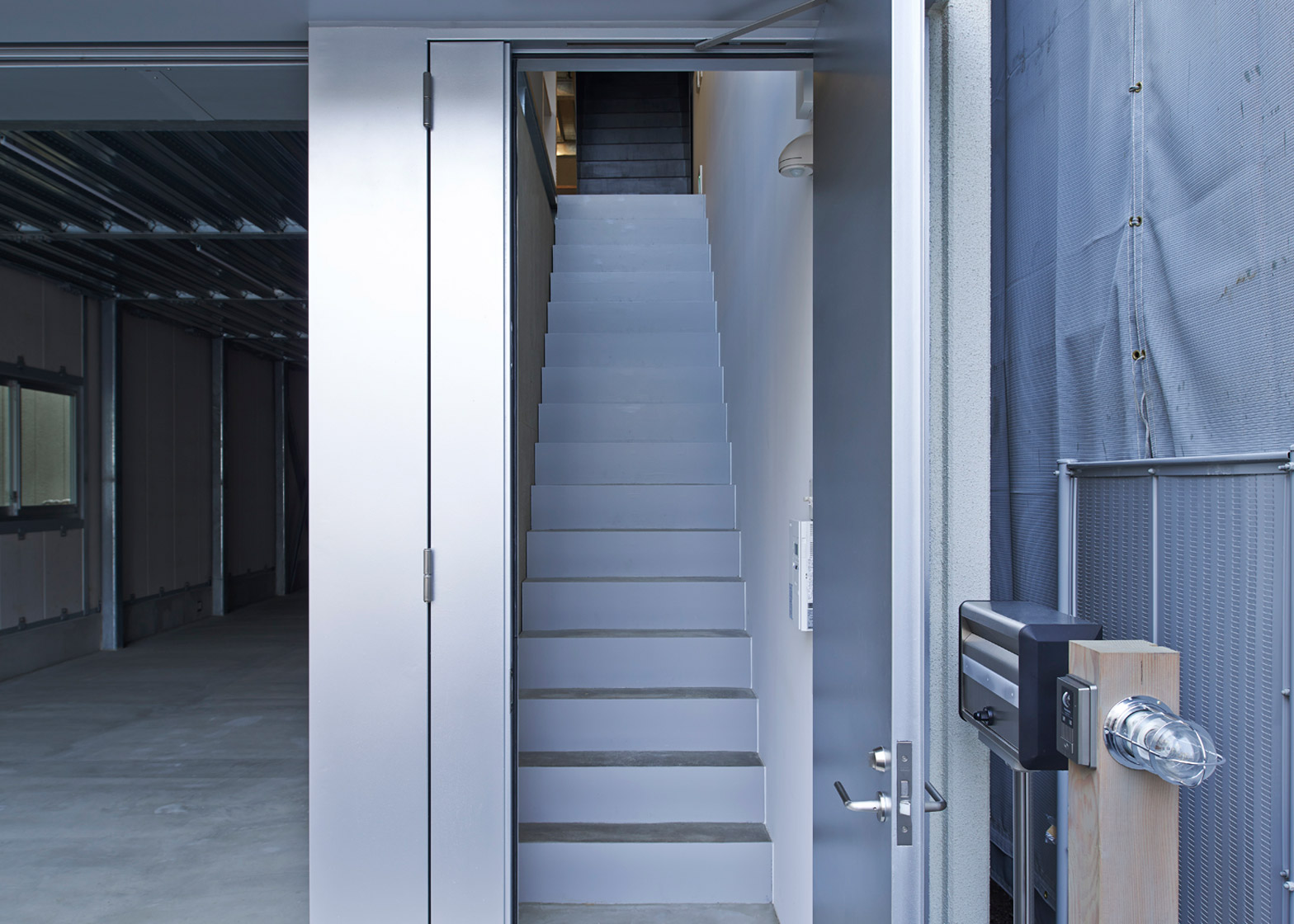 Ninkipen! wedges galvanised metal office for a construction firm between Tokyo blocks