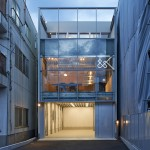 Ninkipen! wedges galvanised metal office for a construction firm between Tokyo blocks