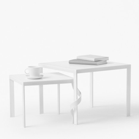 "Nendo's Tangle side tables entwine together ""as if holding hands"""