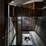 Zen House is a home for three Buddhists organised around a light-filled atrium