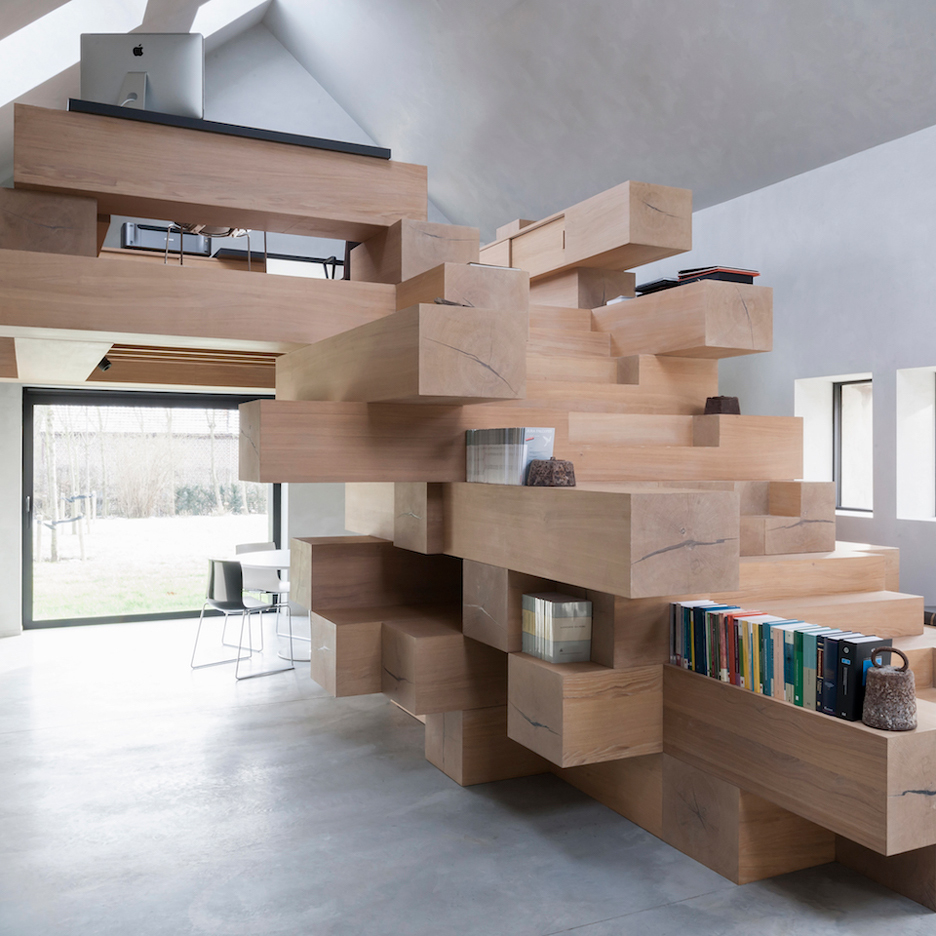 Stacked beams form Jenga-like workspace inside converted barn in Belgium