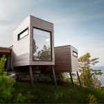 Rever & Drage's holiday cabin features wooden pods that frame views of a Norwegian fjord