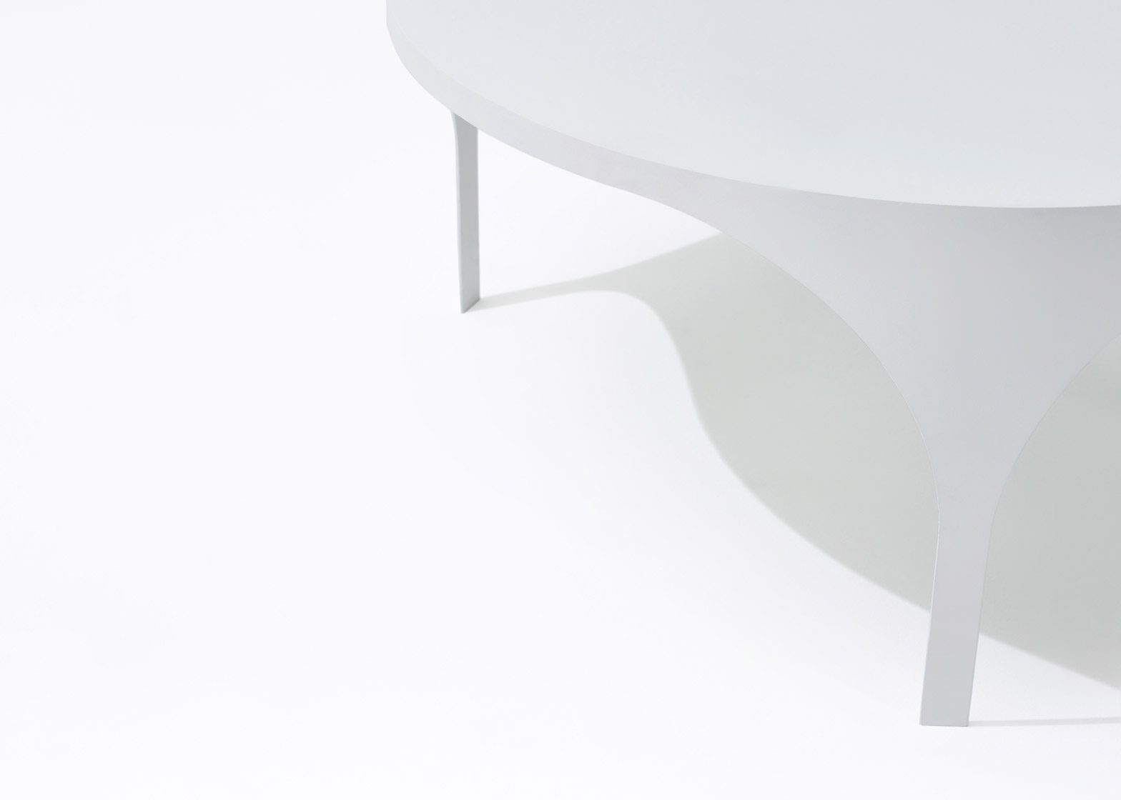 White coated steel coffee tables designed by Boardgrove Architects