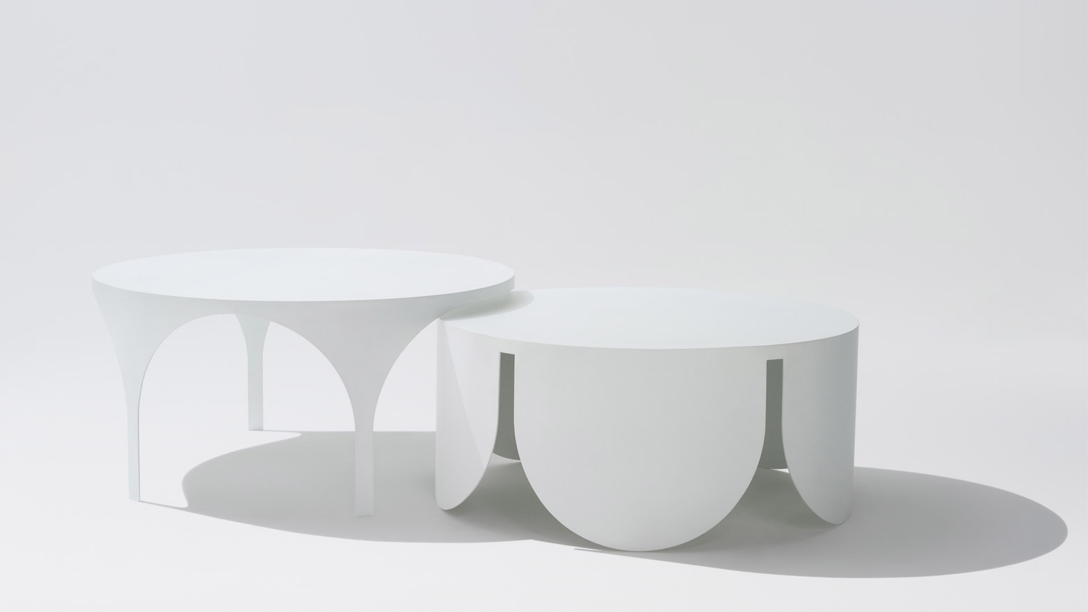 BoardGrove Architects designs two coffee tables with opposite shapes