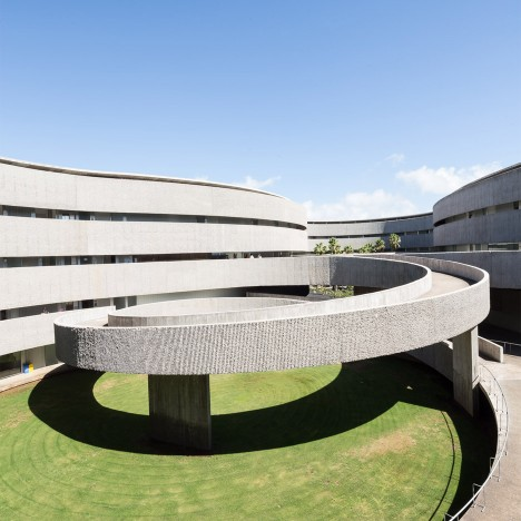 Bands of corduroy-textured concrete wrap GPY Arquitectos' undulating art school in Tenerife