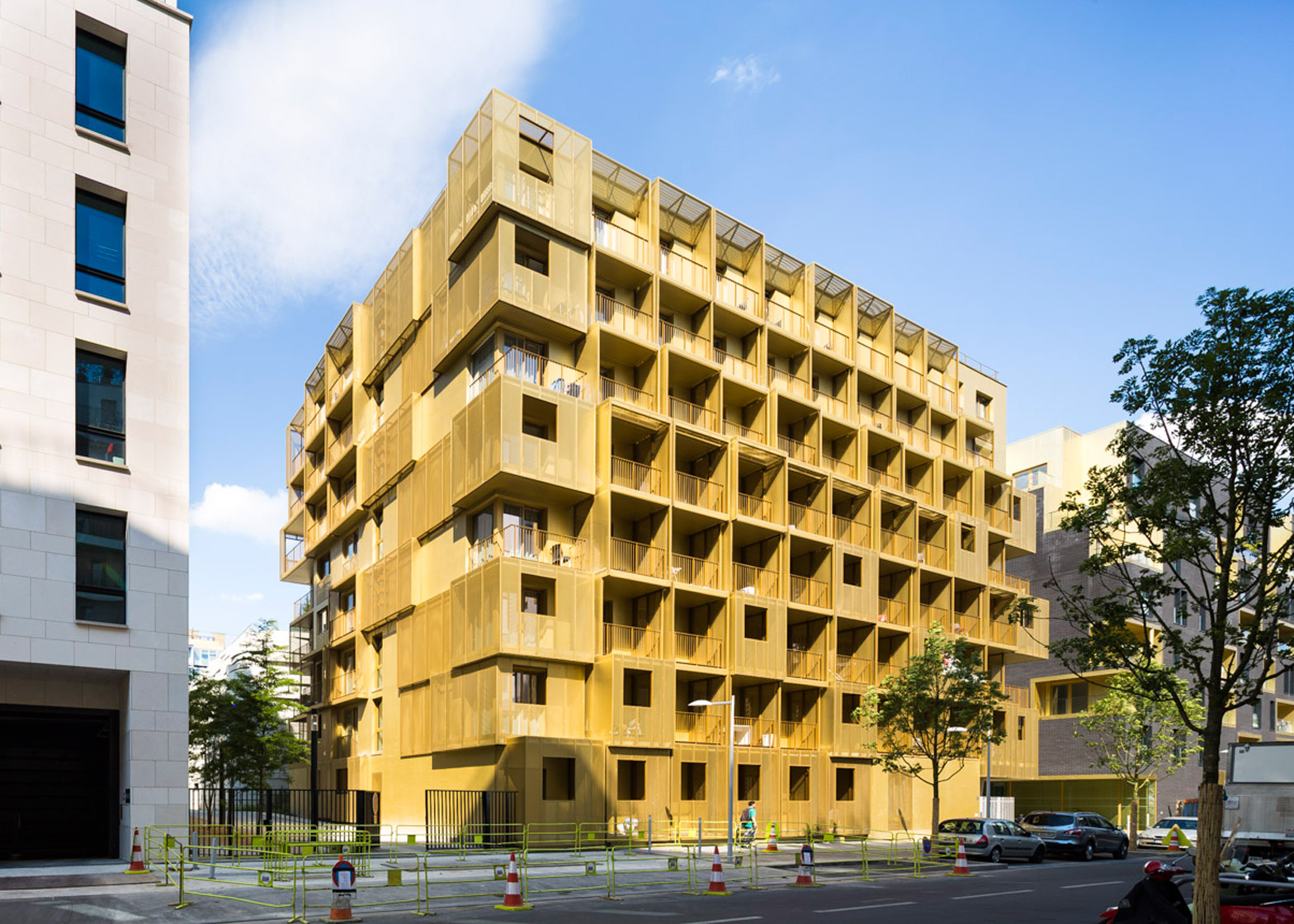 Hamonic+Masson completes student housing with a facade of golden cubes
