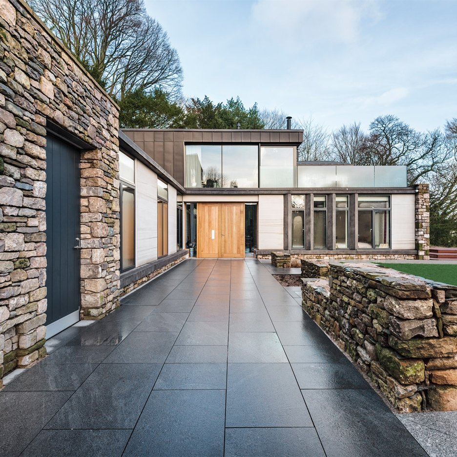 Bennetts associates creates contemporary stone and zinc for Modern stone houses architecture