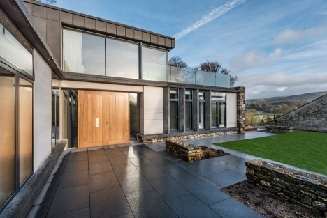 Bennetts Associates creates contemporary stone and zinc country house in Cumbria