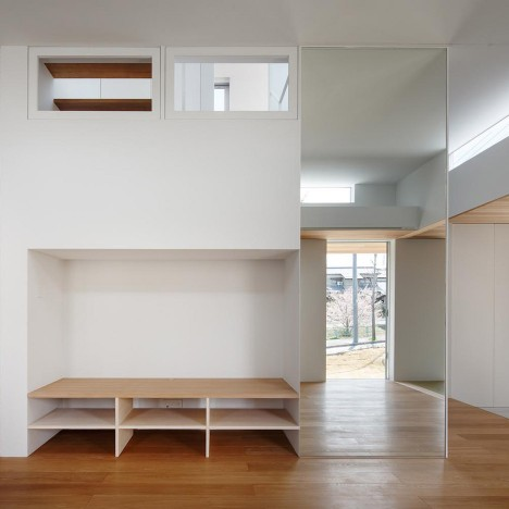 Mirrors and white walls draw light through House in Okazaki by Kazuki Moroe Architects