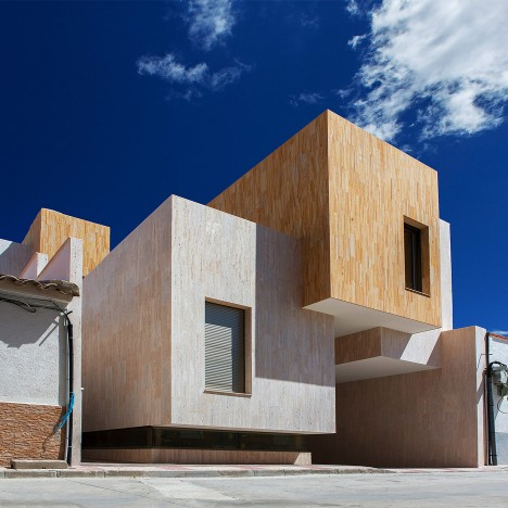 Stone-covered blocks make up staggered Spanish residence by OOIIO Architecture