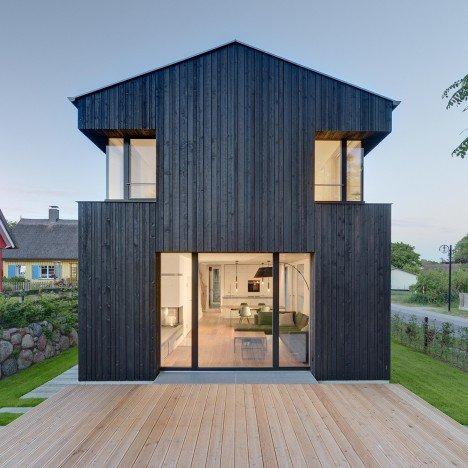 House Wieckin by Möhring Architekten features black-painted walls and deep corner windows