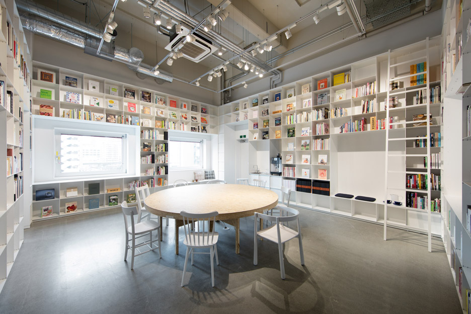 Hue Plus kitchen studio and library housed in a renovated warehouse building in Tokyo, Japan by Schemata Architects