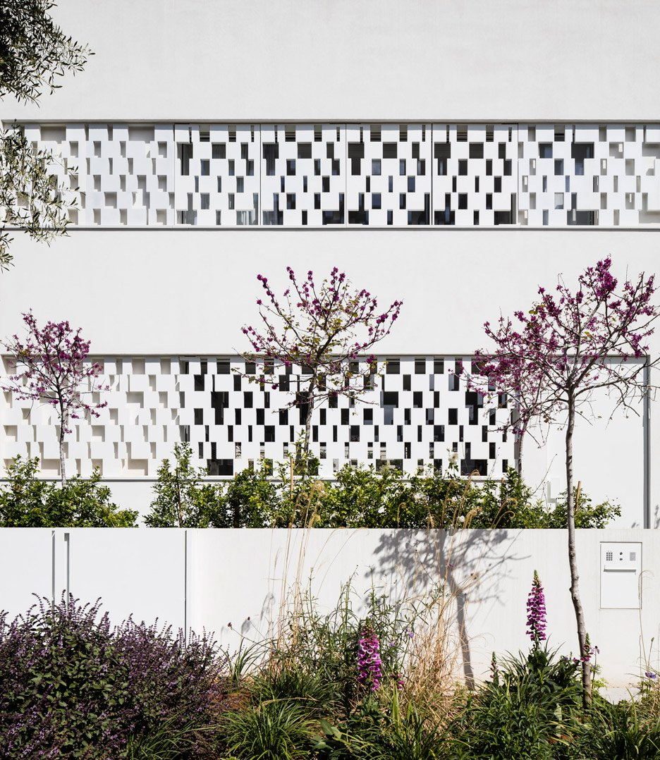 Perforated shutters create geometric facade for Pitsou Kedem's house in Tel Aviv