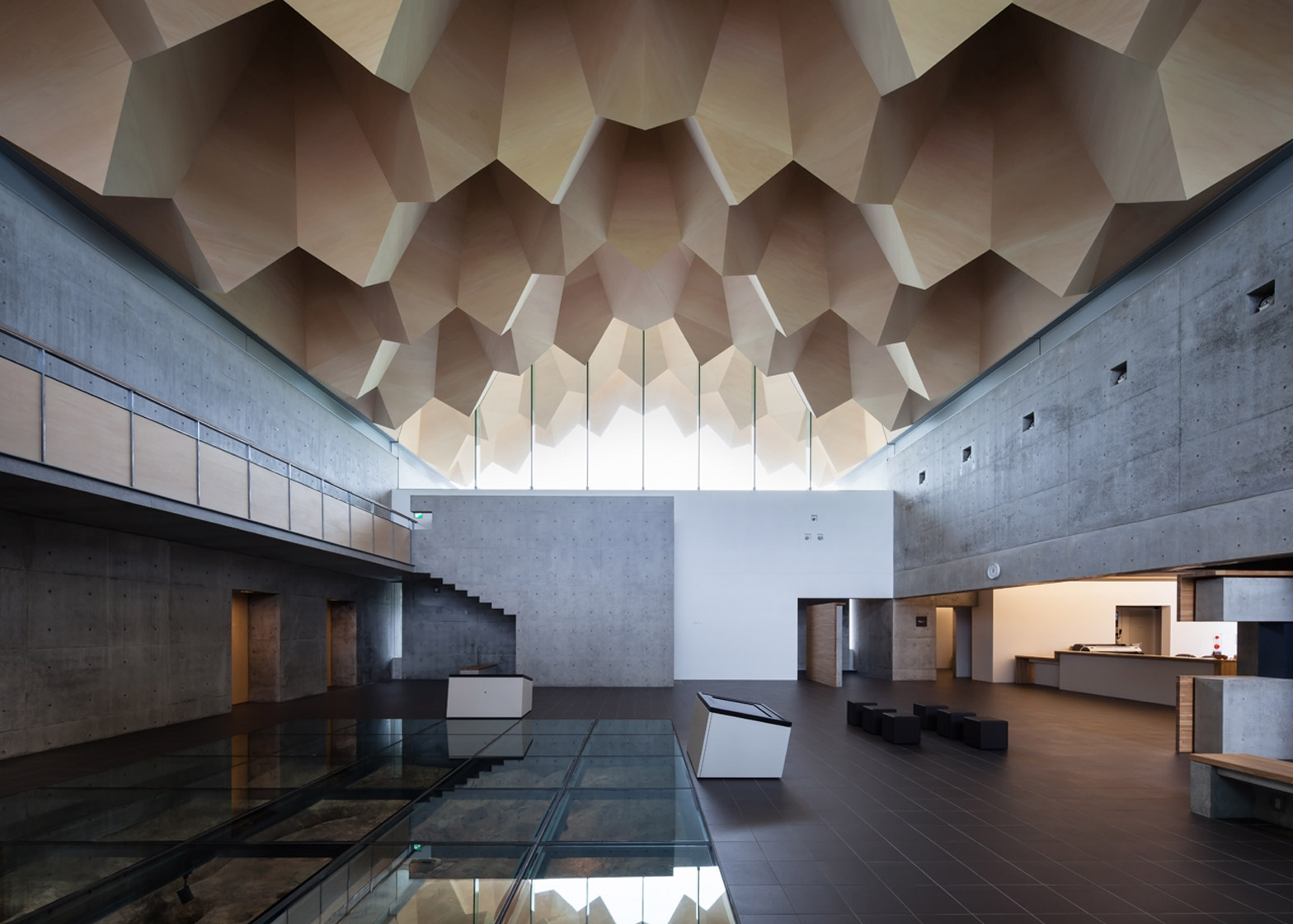 Jagged wooden roof frames museum dedicated to Japan's Jōmon period by Furuichi and Associates