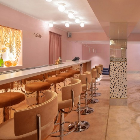 AKZ Architectura designs soft pink interior for champagne bar in Kiev