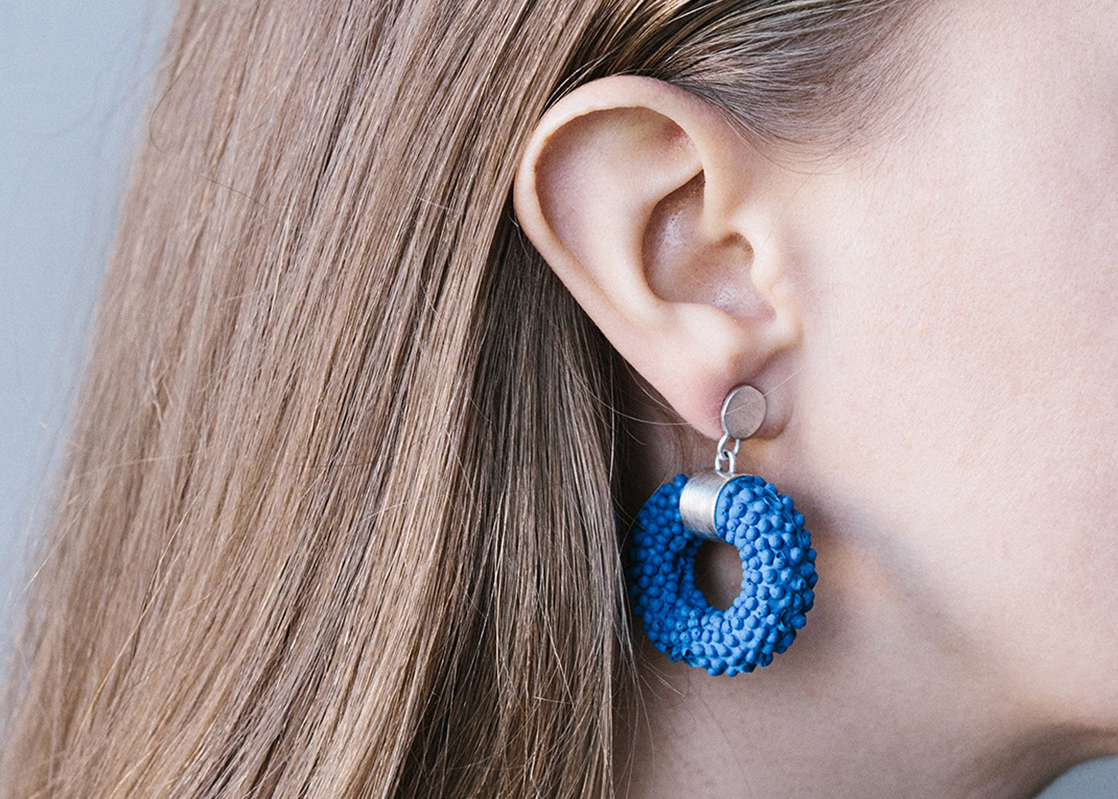 Nautilus Silver Silicone Earring by Dovile Bertulyte