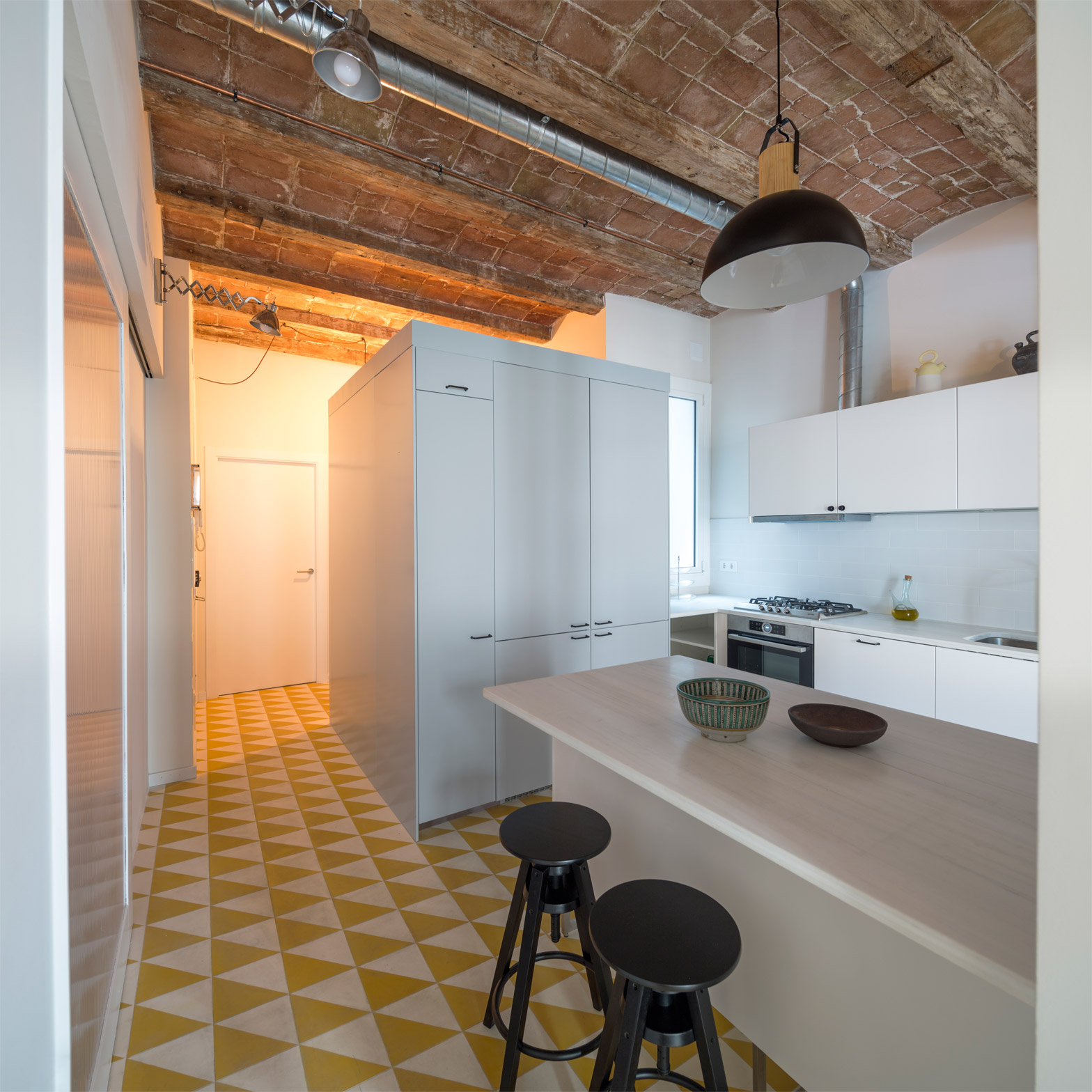 Nook Architects adds new openings to Barcelona apartment