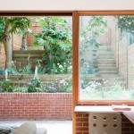 Herringbone parquet and stained ply cabinetry feature in London extension by Nimtim Architects