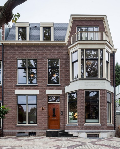 Balconies and full-storey windows added to villa in a former Dutch museum