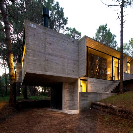 Luciano Kruk and María Victoria Besonías nestle exposed concrete holiday home in forest glade