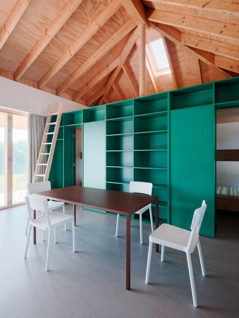 JRKVC's lakeside house optimises small footprint with hidden attic areas