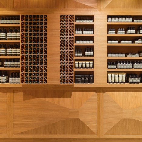 Snøhetta lines Aesop store in Oslo with faceted oak panelling