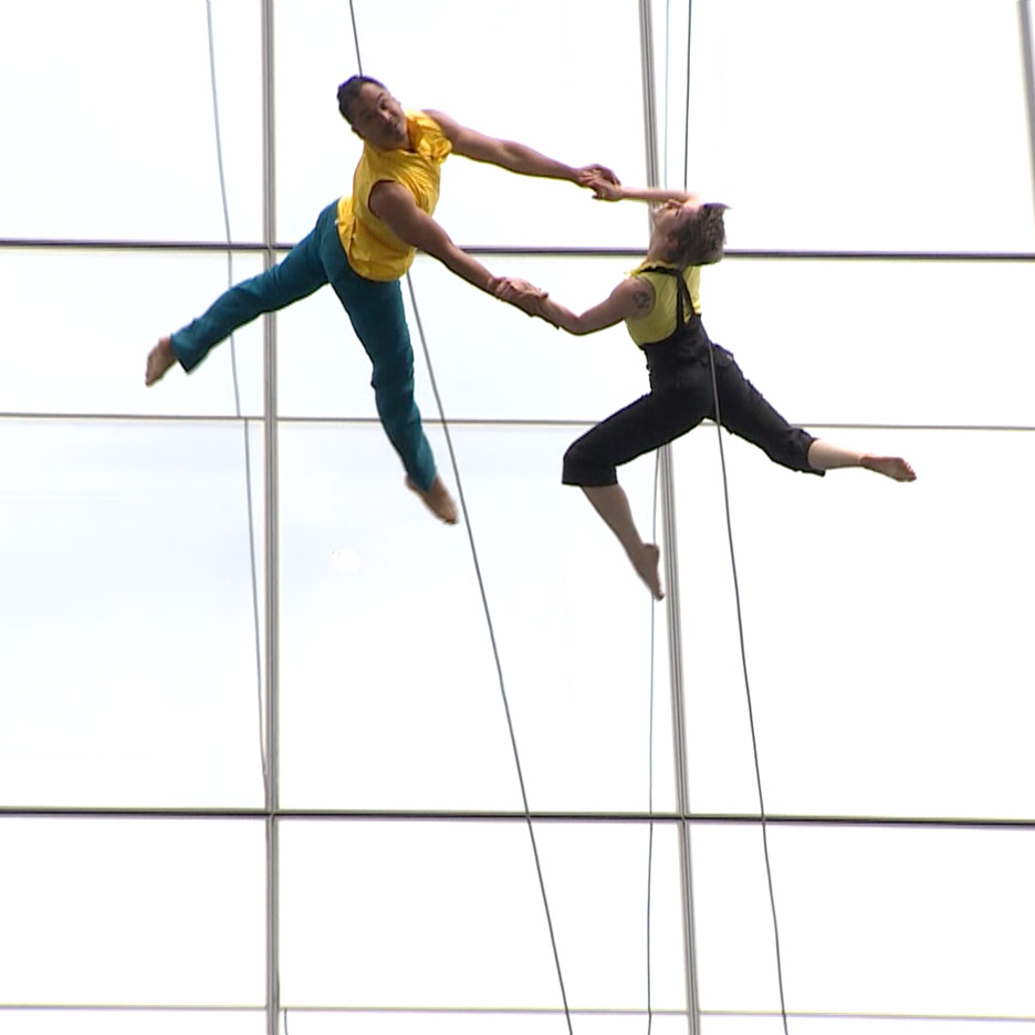 Mid-air dancing performance on the side of 100 North Avenue in Boston, Massachusetts, USA by Bandaloop