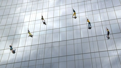 Dancers perform vertical routine across Boston building facade