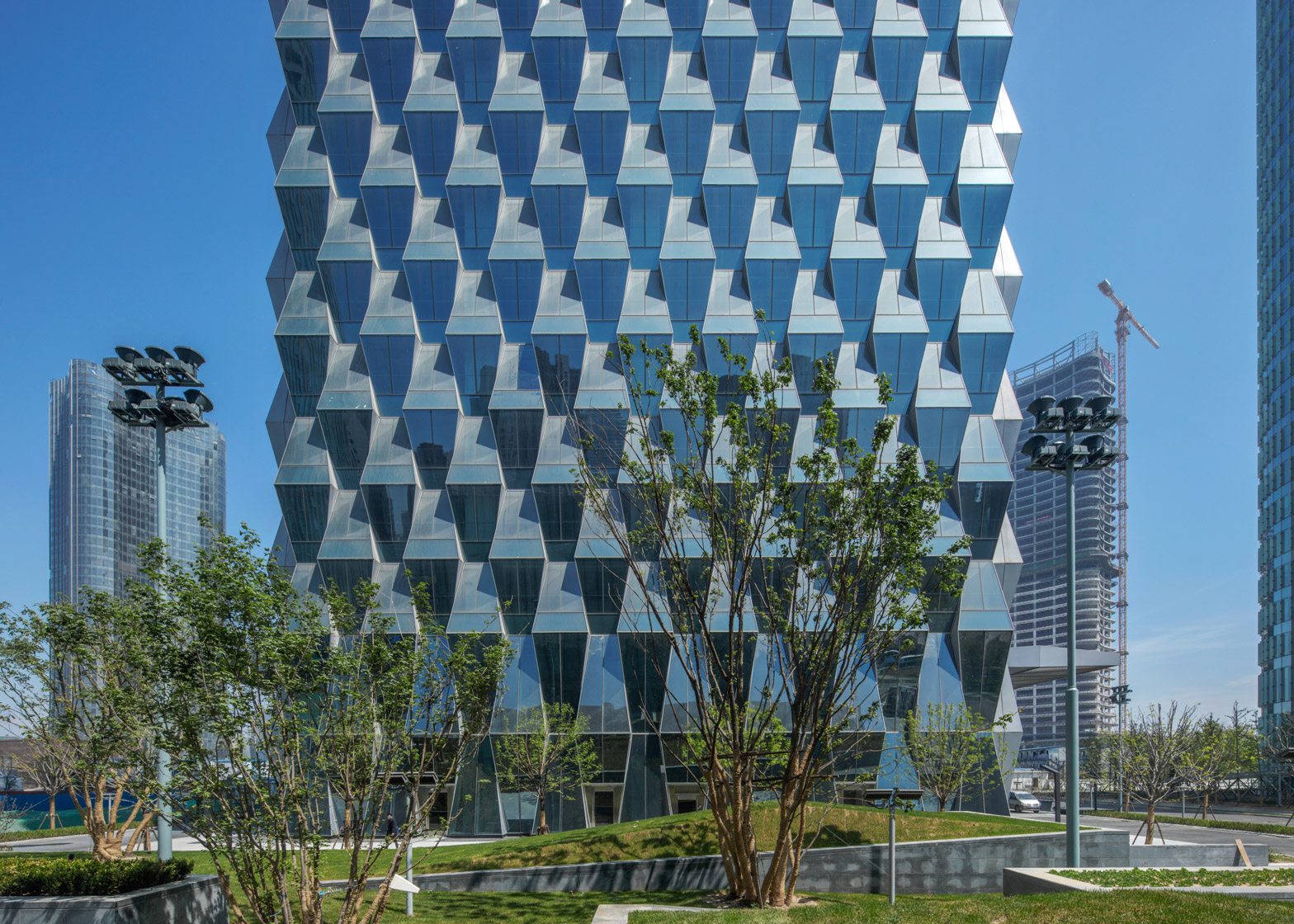 Beijing Greenland Centre by skidmore Owings and Merill is a 55 storey tower with prism-like glass cladding