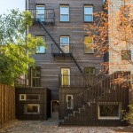 Architensions clads rear facade of historic Brooklyn townhouse in charred wood