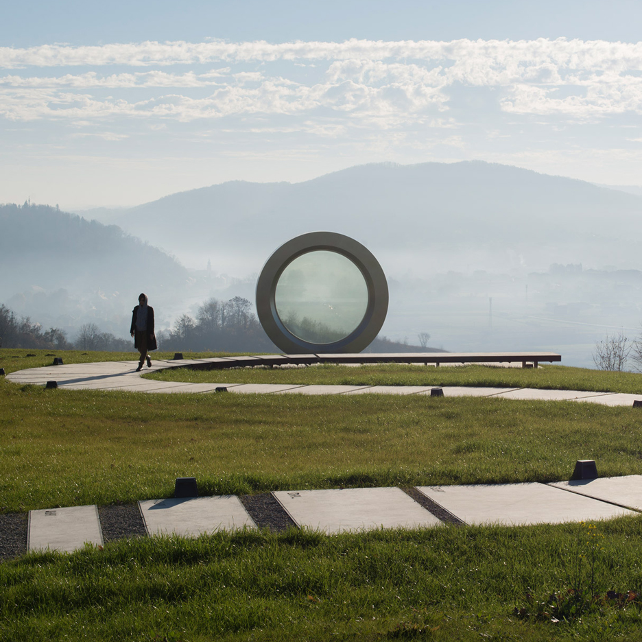 NFO designs giant broken camera lens to honour photojournalist killed in Yugoslav Wars