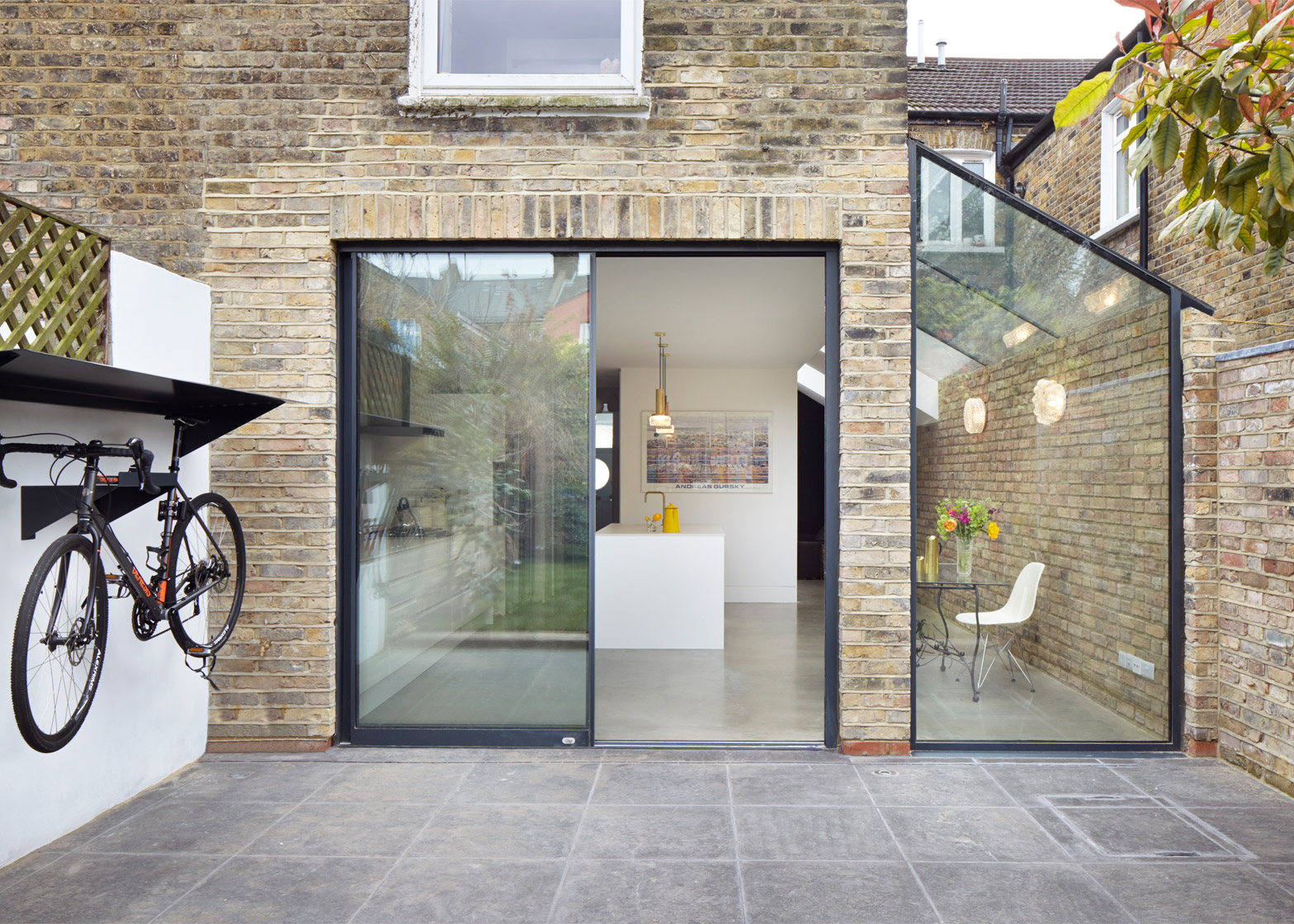 rise design studio adds glass extension to london house