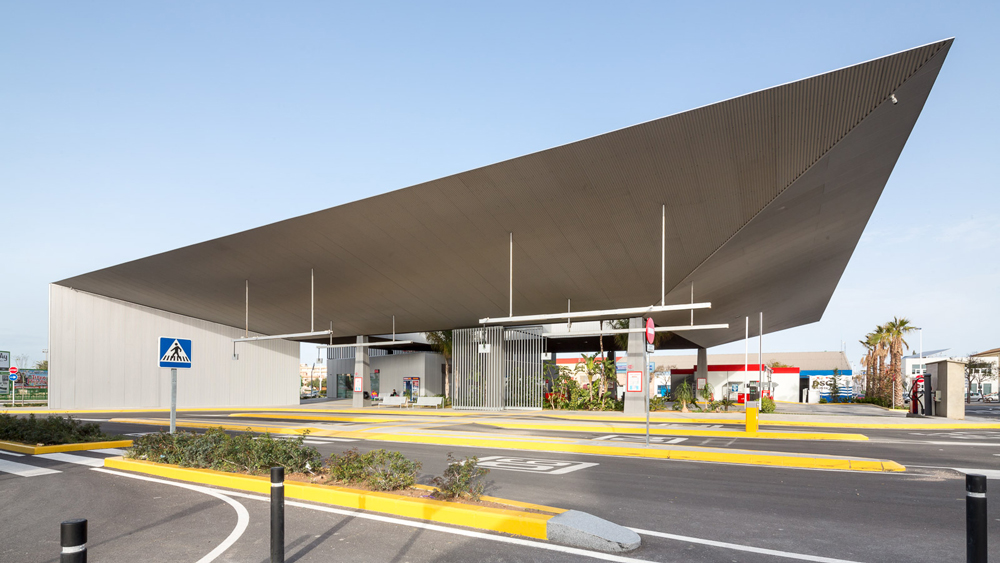 Slender canopy shelters passengers at Santa Pola Bus Station - Dezeen
