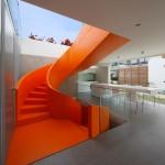 Martin Dulanto installs vibrant orange staircase inside Peruvian house Casa Blanca