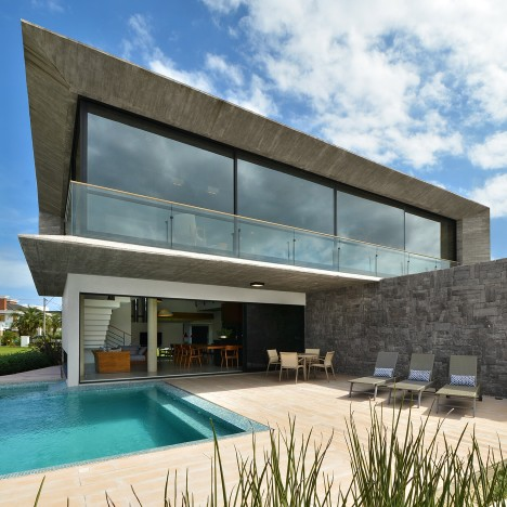 Angular concrete slabs frame Brazilian house Casa Bosques