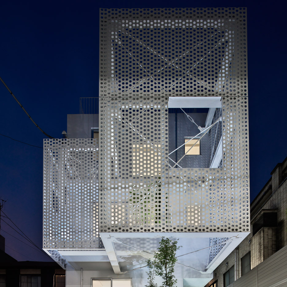 Hiroyuki moriyama completes tokyo apartment building with a perforated skin perforated steel panels